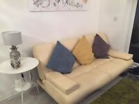 Sofa bed in cream faux leather