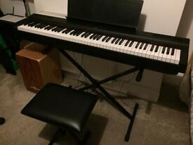 Yamaha P-125 electric piano, stand, seat