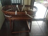 Brown wicker Moses basket with rocking stand