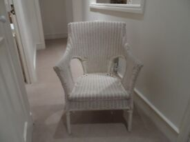 A pair of cream painted cane chairs
