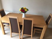Oak-effect dining table and chairs