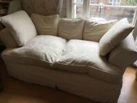 Two seater feather sofa Used in good comes with two sets of removal washable covers