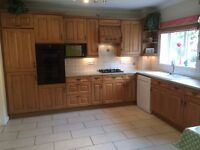 Kitchen base and wall units in light/mid oak. Complete kitchen including ceramic sinks etc