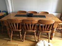 Solid pine wood dining table with 8 chairs 2 with arms