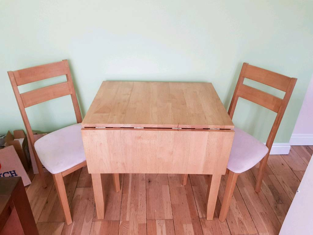 Solid wood extendable dining table and 2 chairs
