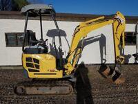 New Holland Kobelco E18 SR 1.8 Mini digger. 1.8 tonne mini digger. Expanding tracks Zero tailswing!
