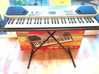 Casio CTK 491 electric keyboard and stand