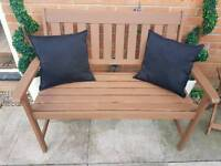 Two black outdoor garden cushions for 2 seater bench
