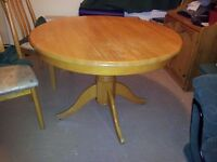 small pine dining table with 4 chairs