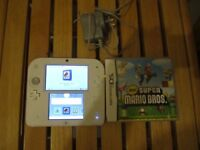 NINTENDO 2DS,RED WHITE COLOR,WITH SUPER MARIO BROS GAMES AND CHARGER