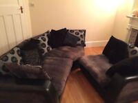 Black corner sofa with cushions