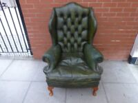 A Green Leather Chesterfield Queen Ann Armchair