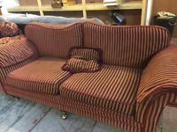 Large red striped sofa