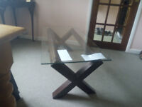 Glass and wood table. 4ft x2ftx2ft. very good condition. easy storage.
