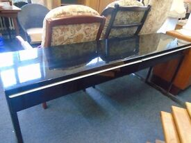 long black metal table with 2 drawers.
