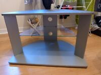 Grey TV unit with glass