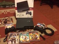 Sony PlayStation 3 boxed with games