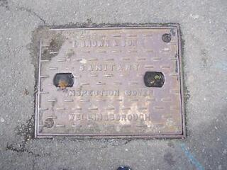 Manhole cover - cast iron - e brown & son