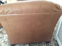 Natuzzi brown leather three piece suite.