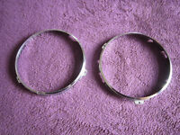 A pair of classic 7 inch headlamp retaining rings in chrome