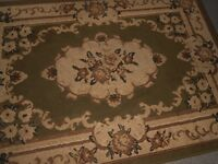 two matching hard back pattern rugs