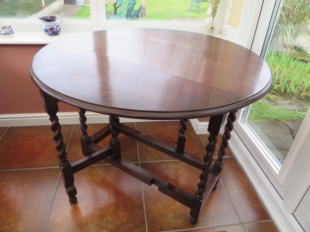 Dark oak, drop leaf, barley twist dining table