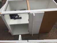 Assortment of white kitchen units