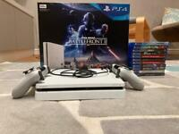 PS4 Slim console, 11 games, 2 controllers and charger, and the original box