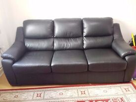 3 Seater and 2 Seater Sofas in black bonded leather. (Excellent condition, Like New)