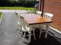 Great family dining table and 4 chairs.