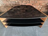 3 tier TV stand. Black, glass shelves & wooden frame. Good condition.