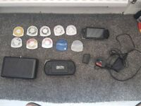 Sony psp unboxed, 8 games, 2 game cases, 1 soft case and 1 hard case.
