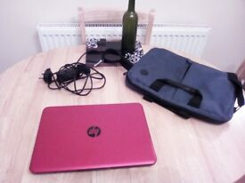 Red hp laptop with charger and laptop bag £180 ovno