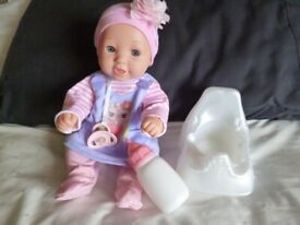 Doll that drinks/uses potty. Dressed/dummy/potty and bottle GC