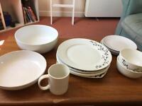 Plates, small plates, bowls, mug, salad bowl.
