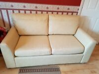 Cream faux leather sofa bed