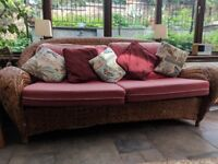 Cane sofa, armchair and table. Cushions in need of recovering.