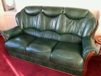 Three Piece Leather Suite consisting of three seat sofa and two recliner chairs
