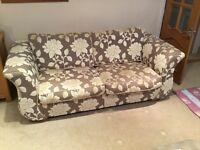 Large floral design sofa