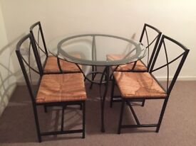 Ikea dining set with round glass table 4 chairs