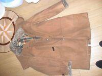 Toggi Tan canvas coat with tartan lining and curly sheepskin collar and cuffs