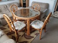 Cane dining table with 4 matching chairs.