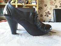 Dorothy Perkins black heeled shoes (Size 7)