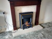 Electric fire, hearth and surround