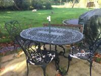 Metal ornate garden table, chairs and bench