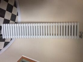 White cast iron 4 column radiator complete with chrome valves in perfect working order