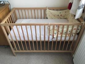 Baby cot with mattress and two sheets