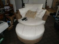 large cuddle chair and footrest in cream