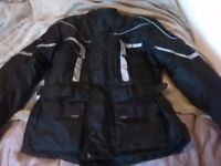 Ladies small motorbike jacket and matching trousres, in excellent condition, never worn.