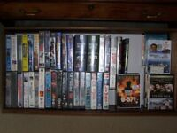 VHS and DVDs for sale.